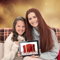 Composite image of mother and daughter showing tablet