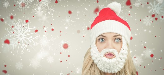 Composite image of funny girl in santa beard