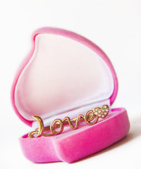 gold ring in a box heart