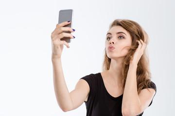 Beautiful woman making selfie photo