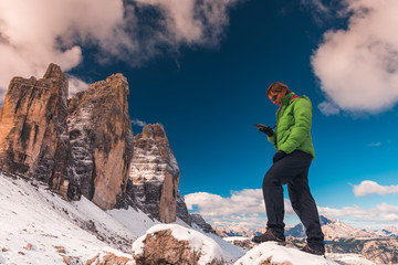woman with GPS navigator in hand  Dolomites Alps