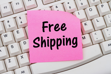 Online shopping with Free Shipping, computer keyboard and sticky