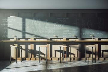 Vintage university classroom with equation solution on blackboar
