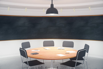 Modern conference room with furniture and blank blackboard on th