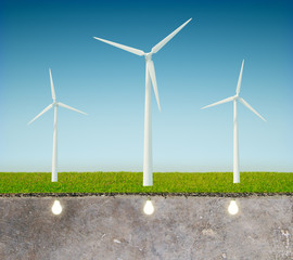 Gree energy concept with windmill, blue sky and light bulbs