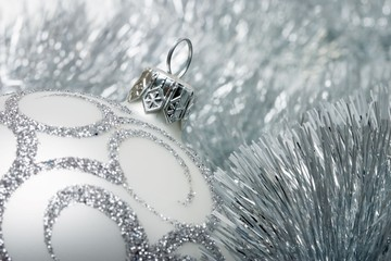 Christmas decoration on the silver tinsel background
