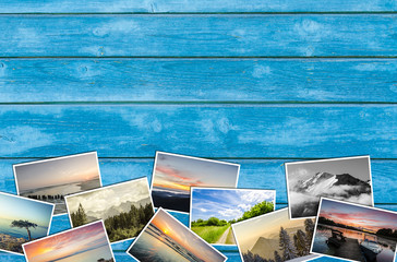Travel photos on wooden background