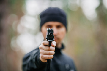 man with gun on a outdoor background