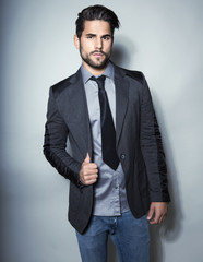 handsome young man in suit on grey background. Business man