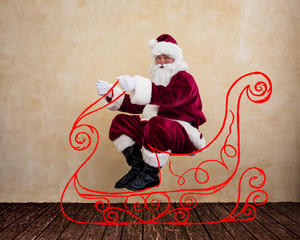 Santa Claus drive in imaginary sleigh