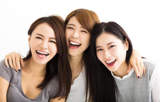 Closeup happy Young Women Faces Looking at Camera