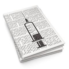 Medicine concept: Syringe on Newspaper background