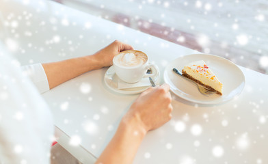 close up of woman hands with cake and coffee