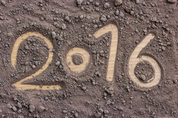 2016 made by soil on wood background.New Year 2016 concept