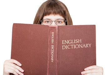 girl looks over English Dictionary book isolated
