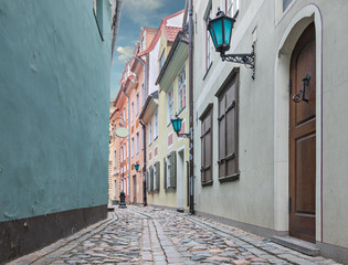Medieval street in old Riga city. Riga is the capital and largest city of Latvia, a major commercial, financial, cultural, historical and tourist center of the Baltic region.