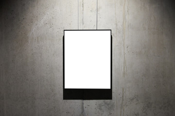Empty black frame on concrete wall