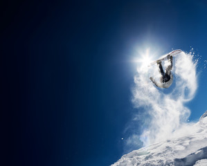 Stores à enrouleur Glisse hiver Snowboarder making high jump in clear blue sky. Concept: fun, sport, courage, adventure, danger, extreme. Large copy space on the left side.