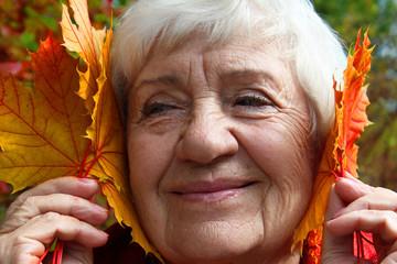 Autumn. happy, elderly woman