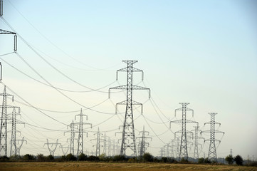 Electricity pylons on the field - daytime shot
