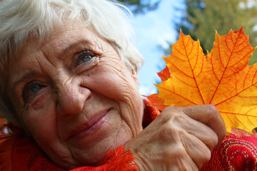 Autumn. happy, elderly woman