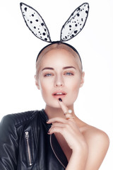 Beautiful attractive young model with blonde hair and black bunny ears.