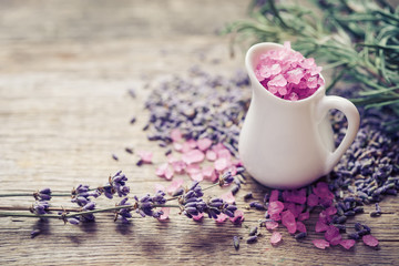 Jug of sea salt  and dry lavender flowers. Selective focus.
