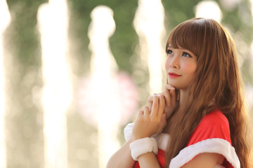 Portrait of beautiful Asian female santa in Christmas