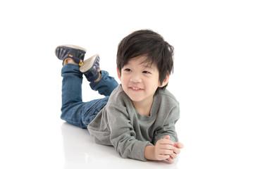Cute asian boy lying