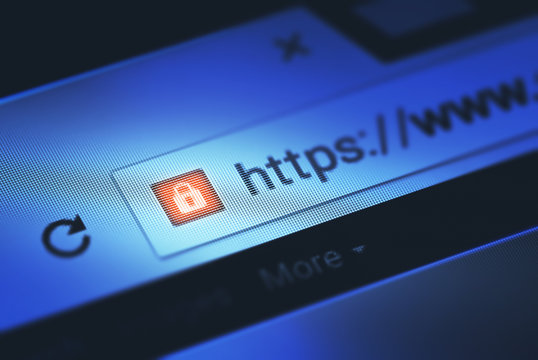 Closeup on the screen with depth of field and focus on the padlock. The image is a security concept in the search engine and web browser address. Hyper Text Transfer Protocol Secure (https).