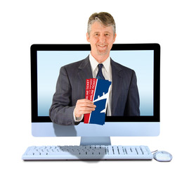A smiling online travel agent coming out of a computer with airline tickets in his hand representing online travel agency agent, business travel and vacation plans.