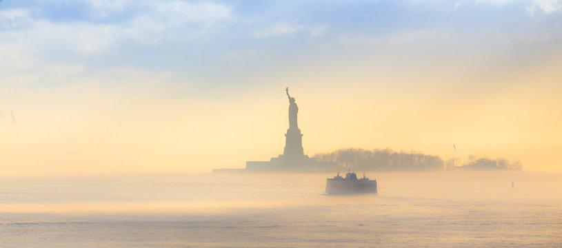 Staten Island Ferry cruises past the Statue of Liberty.