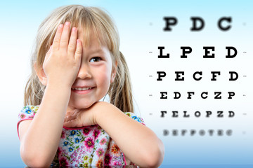 Cute little girl reviewing eyesight.