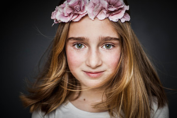 Portrait of a young girl wearing a flower headdress