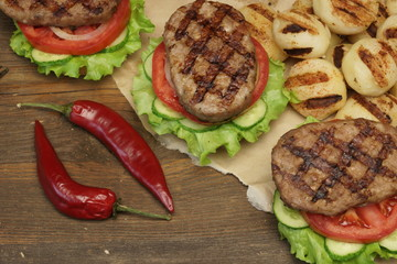 Lunch With Homemade BBQ Grilled Hamburgers On The Picnic Table