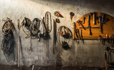 Workbench and tools hanging on a wall in a workshop, Turkey
