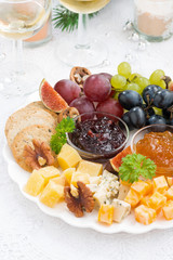 delicious cheese and fruit plate to the holiday on table