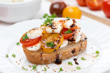 piece of ciabatta with mozzarella and colorful cherry tomatoes