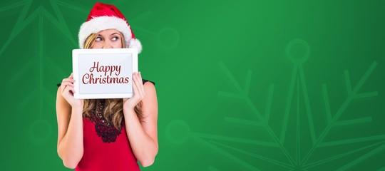 Composite image of festive blonde showing a tablet