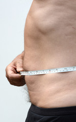 Flat Male stomach in profile with tape measure