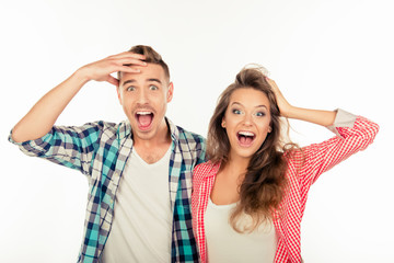 Pretty funny cheerful couple  showing surprise