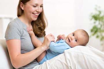 mother with her small baby in nursery room