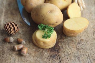 fresh potatoes on wood background