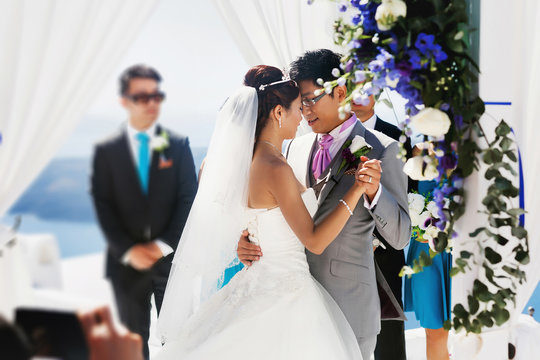 stylish rich asian bride and groom dancing first wedding dance i