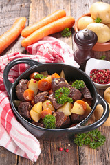 beef stew with wine sauce and vegetables