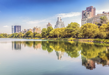 Central Park reflected in lake, New York City, USA.
