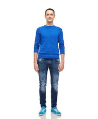 smiling young man in blue pullover and jeans
