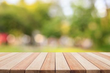 Empty top wooden table and sunny abstract blurred bokeh backgrou