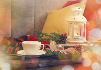 Still life interior details, cup of coffee, candles and Christma