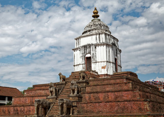 The Fasidega temple in Bhaktapur is visited every year by thousands of Hindu pilgrims. The shrine is dedicated to Shiva and it sits atop a six-level plinth with guardian elephants, lions and cows.